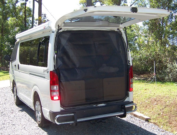 Above Sun Shield Cabin Set installed on 2005 year model Toyota Hiace. Left Tailgate Insect Screen Assembly installed on 2005 year model Toyota Hiace. & Top Gear 2 Go